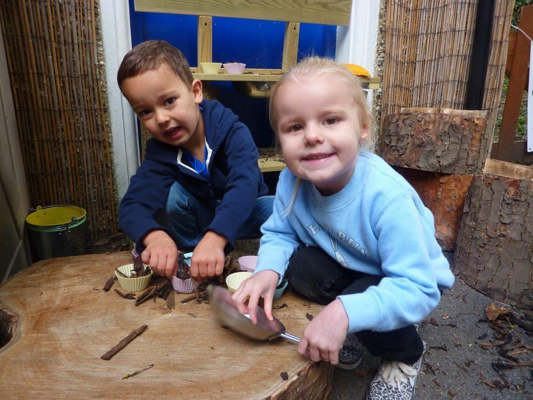 Enjoying the mud kitchen together